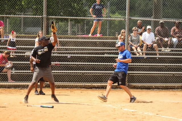 A Screaming Eagle Soldier looks to make the play at home plate in the Annual Tobacco Stick Softball Game June 1, 2019, Clarksville, Tennessee. This is the 10th year the game has been played between the 101st Airborne Division (Air Assault) and Clarksville-Montgomery County government employees. U.S. Army Photo by Spc. Jeremy Lewis.