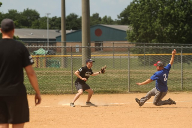 A Fort Campbell Soldier gets the out at third during the Annual Tobacco Stick Softball Game June 1, 2019, in Clarksville, Tennessee. This is the 10th year the game has been played between the 101st Airborne Division (Air Assault) and Clarksville-Montgomery County government employees. U.S. Army Photo by Spc. Jeremy Lewis.