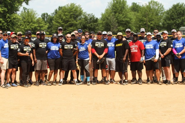 The Screaming Eagle and City-County teams pose for a group photo following the Annual Tobacco Stick Softball Game June 1, 2019, Clarksville, Tennessee. The City-County team ended a 3-year-drought defeating the Soldiers 17-8. This is the 10th year the game has been played between the 101st Airborne Division (Air Assault) and Clarksville-Montgomery County government employees. U.S. Army Photo by Spc. Jeremy Lewis.