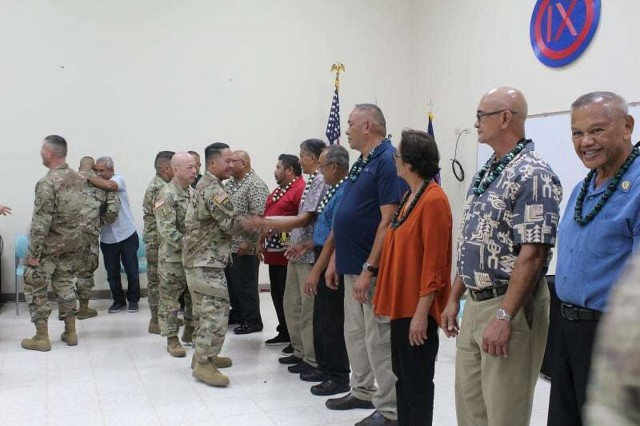 U.S. ARMY RESERVE CENTER BARRIGADA, Guam - 27 U.S. Army Reserve retirees and their families in Guam and the Commonwealth of the Northern Mariana Islands, recognizing and honoring each retiree and their family at an official retirement ceremony. Soldiers and their spouses from the 368th Military Police Co., 797th Engineer Co., 302nd Quarter Master, 3303rd Mobilization Support Brigade and the Theater Support Group - Det. Marianas were recognized. (Photo by Master Sgt. Ed Daileg, U.S. Army)