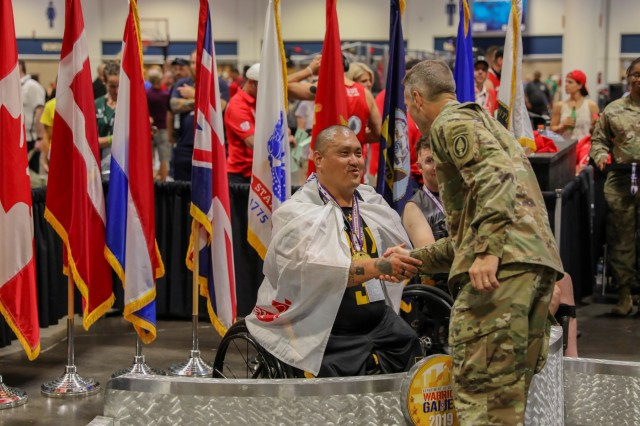 U.S. Army retired Staff Sgt. Matther Lammers paticipates in the indoor rowing event, June 25, 2019, at the Tampa Convention Center during the 2019 Department of Defense Warrior Games. The DoD Warrior Games are conducted June 21-30, hosted by Special Operations Command, Tampa, Florida. It is an adaptive sports competition for wounded, ill and injured service members and veterans. Approximately 300 athletes repesenting teams from the U.S.Army, Marine Corps, Navy, Air Force, Special Operations Command, United Kingdom Armed Forces, Australian Defence Force, Canadian Armed Forces, Armed Forces of the Netherlands, and the Danish Armed Forces will compete in archery, cycling, shootinbg,sitting volleyball, swimming, track, field, wheelchair basketball, indoor rowing, powerlifting, and for the first time in Warrior Games history, golf, wheelchair tennis, and wheelchair rugby. (U.S Army photo by Pfc. Dominique Dixon)