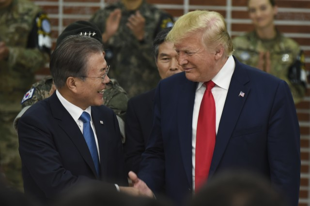 President of the United States, Donald J. Trump and South Korean President, Moon, Jae-in, shake hands during a visit at the dining facility at the Joint Security Area, Panmunjon, June 30, 2019 as part of his two-day state visit to South Korea. During his visit, Trump will participate in a series of bilateral and cultural engagements demonstrating continued commitment to the alliance between the United States and the Republic of Korea.