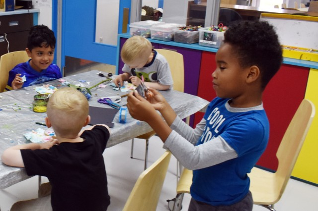 Kalib Kennedy, right, 5, works on a project during a CreArtivity class for children ages 4 to 6 at the SKIES Unlimited building at the Sagamihara Family Housing Area June 27. Nahum Giron, left, 6, looks on.
