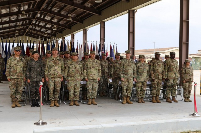 CAMP HUMPHREYS, Republic of Korea - Soldiers and Leaders from the 2nd Infantry Division/Republic of Korea-U.S. Combined Division sing the Warrior March after the ribbon cutting to celebrate the opening of the Warrior Behavioral Health Clinic on Camp Humphreys, June 27. The clinic was designed to assist the division's goal of Soldier readiness by providing behavioral health services and resiliency advice. (U.S. Army photo by Staff Sgt. Cody Harding, 2ID/RUCD Public Affairs)