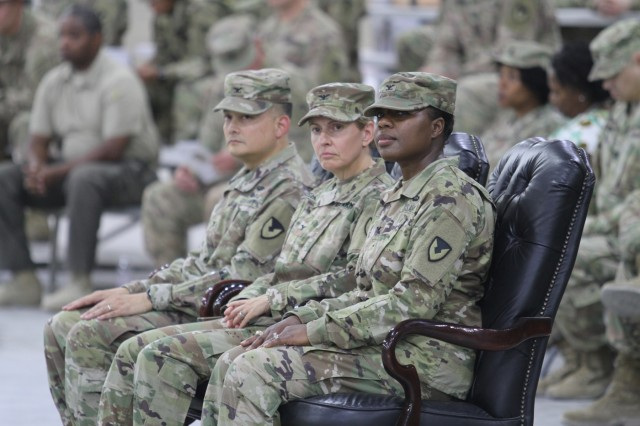 Seated from right are Col. Mary O.B. Drayton, incoming commander, 408th Contracting Support Brigade; Col. Christine A. Beeler, deputy to the commanding general for outside the continental United States Operations, U.S. Army Contracting Command; and Col. Ralph T. Borja, outgoing commander, 408th CSB; during the change of command ceremony June 27, 2019, at Camp Arifjan, Kuwait. Borja completed his one-year tour with the 408th CSB and is returning to his family in Fort Belvoir, Virginia. This is Drayton's third assignment within the 408th CSB.
