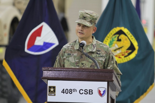 Colonel Ralph T. Borja, the outgoing commander of the 408th Contracting Support Brigade, addresses the Soldiers, civilians and contractors of the unit for the final time during the change of command ceremony June 27, 2019, at Camp Arifjan, Kuwait. Borja led the 408th CSB since June 2018 and ensured the successful awarding, managing and administration of more than $11 billion in contracts across the U.S. Army Central area of responsibility.