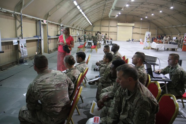 Margaret Giller, standing, safety specialist, Area Support Group-Kuwait, briefs Soldiers about the potential hazards while driving in Kuwait during a safety fair at Camp Arifjan, Kuwait, June 21, 2019. The safety fair is a highlight of the U.S. Army Central's 101 Critical Days of Summer safety program that encourages leaders to engage with their Soldiers and to stress the importance of being safe in everything they do.