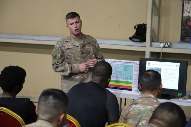 Army Sgt. David Adkin, 184th Expeditionary Sustainment Command, Mississippi Army National Guard, talks about the dangers of heat injuries during the U.S. Army Central's Safety Fair at Camp Arifjan, Kuwait, June 21, 2019. The safety fair is a highlight of the U.S. Army Central's 101 Critical Days of Summer safety program that encourages leaders to engage with their Soldiers and to stress the importance of being safe in everything they do.