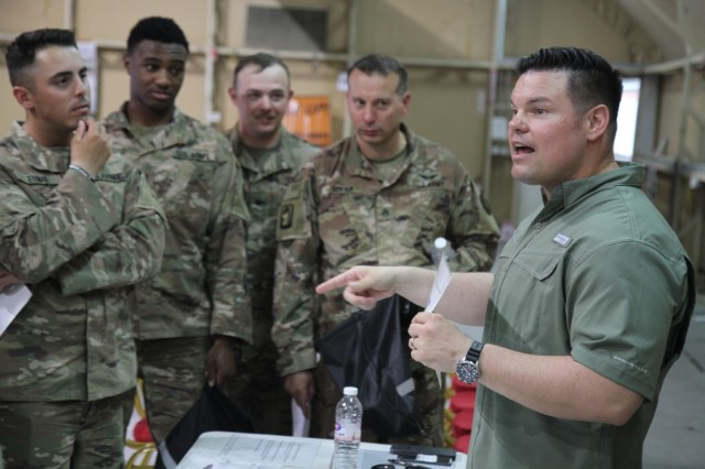 Army Maj. Kristjan Rauhala, right, adjutant, U.S. Army Central (Forward), discusses the importance of firearms safety with attendees at the ARCENT Safety Fair at Camp Arifjan, Kuwait, June 21, 2019. The safety fair is a highlight of the U.S. Army Central's 101 Critical Days of Summer safety program that encourages leaders to engage with their Soldiers and to stress the importance of being safe in everything they do.