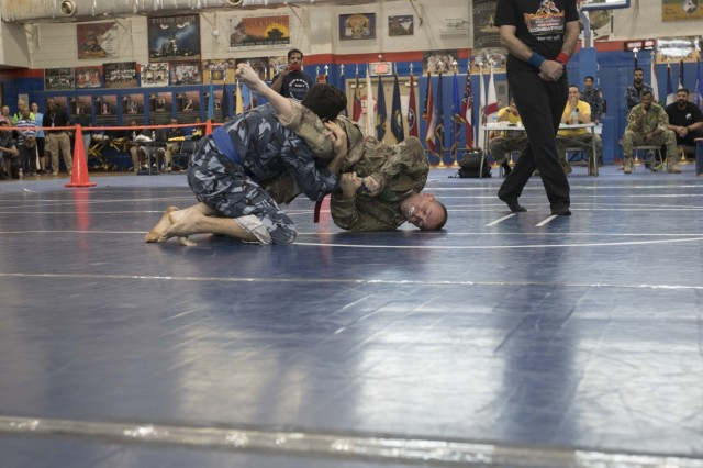 United States Army Sgt. Gene Bills, right, 284th Engineer Company, 961st Engineering Battalion, 420th Engineer Brigade, competes in a combatives tournament at Camp Arifjan, Kuwait, June 23, 2019. U.S. Army Central hosts events such as the combatives tournament to strengthen its relationship and build partner capacity with the Kuwaitis. USARCENT operates throughout the Middle East region and appreciates the generosity of the host nation's willingness to maintain bilateral defense relationships. (Army Reserve photo by Sgt. Christopher Lindborg)