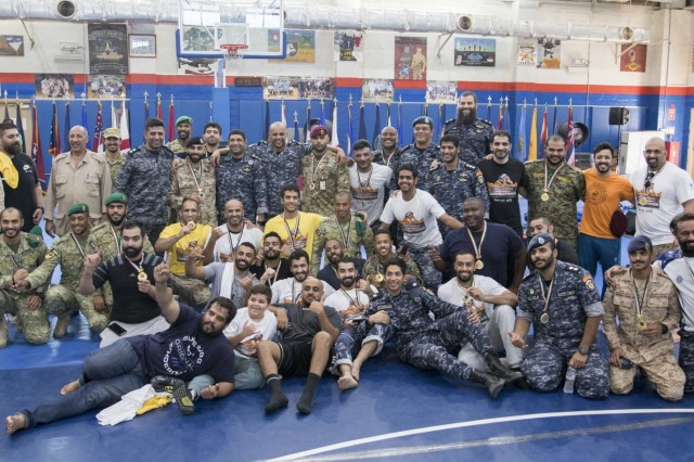 Kuwaiti armed forces pose for a group photo after a combatives tournament at Camp Arifjan, Kuwait, June 23, 2019. U.S. Army Central hosts events such as the combatives tournament to strengthen its relationship and build partner capacity with the Kuwaitis. USARCENT operates throughout the Middle East region and appreciates the generosity of the host nation's willingness to maintain bilateral defense relationships. (Army Reserve photo by Sgt. Christopher Lindborg)