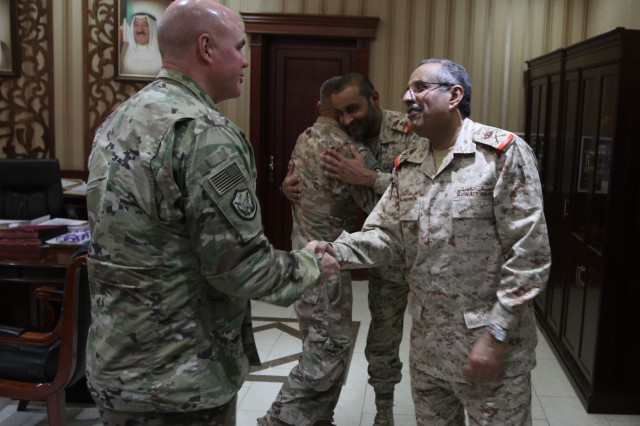 U.S. Army Lt. Col. Tim Harreslon, 184th Sustainment Command, shakes hands with Maj. Gen. Ali A. Al-Shanfa, Kuwait Armed Forces chief of staff for logistics and supply at Kuwait City, Kuwait, June 26, 2019. They discussed upcoming U.S. Army leadership transitions as well as potential partner nation sustainment training opportunities.  (U.S. Army National Guard photo Sgt. Ashley Breland)