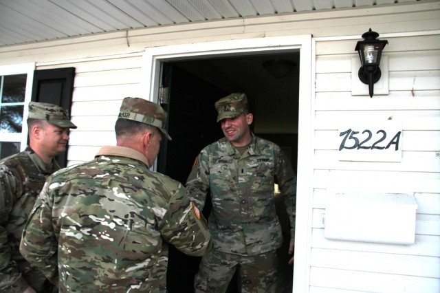 "Maj. Gen. Flem B. ""Donnie"" Walker Jr., commanding general, 1st Theater Sustainment Command (TSC), visits the quarters of 1st Lt. Matthew Stein, executive officer, Headquarters and Headquarters Company, 1st Special Troops Battalion, 1st TSC, at Fort Knox, Ky., March 5, 2019. While there, Walker conducted a thorough inspection to check for any housing deficiencies. (U.S. Army photo by Spc. Zoran Raduka)"