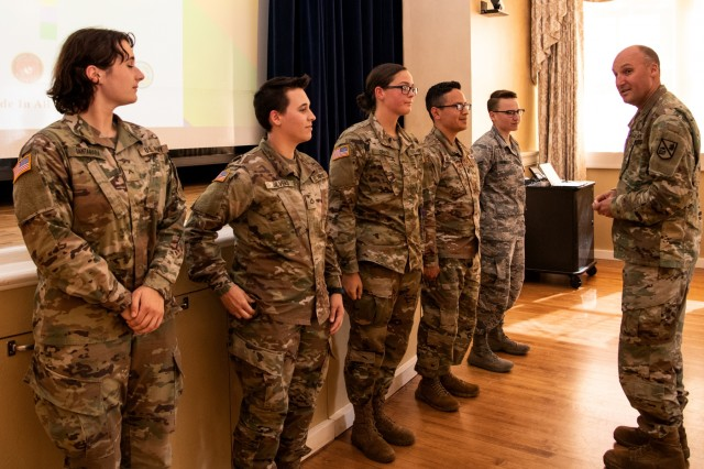 LGBT service members are recognized for telling their stories during an LGBT observance at the Presidio of Monterey, Calif., Thursday, June 27, 2019.