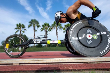 Army Sgt. Jonathan Weasner races a wheelchair during the 2019 DOD Warrior Games in Tampa, Fla., June 22, 2019.