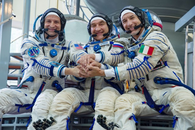 At the Gagarin Cosmonaut Training Center in Star City, Russia, Expedition 58 backup crew members Andrew Morgan of NASA (left), Aleksandr Skvortsov of the Russian Space Agency (center) and Luca Parmitano of the European Space Agency, pose for a photo during training.
