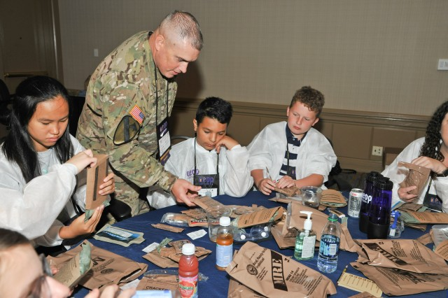 Students learn to prepare MREs -- or Meals Ready to Eat -- during Army Labs Day at eCYBERMISSION in Leesburg, Va., June 18, 2019. Led by the U.S. Army Combat Capabilities Development Command, eCYBERMISSION is a web-based competition that challenges student teams from across the country to develop scientific solutions to problems in their local communities. eCYBERMISSION is part of the Army Educational Outreach Program.