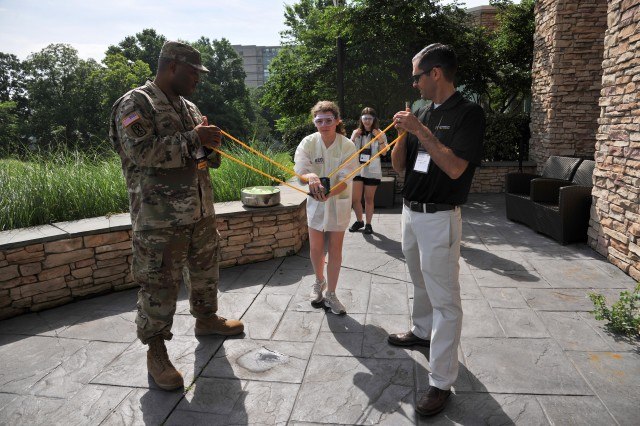"Students participate in ""Water Balloon Ballistics"" during Army Labs Day at eCYBERMISSION in Leesburg, Va., June 18, 2019. Led by the U.S. Army Combat Capabilities Development Command, eCYBERMISSION is a web-based competition that challenges student teams from across the country to develop scientific solutions to problems in their local communities. eCYBERMISSION is part of the Army Educational Outreach Program."