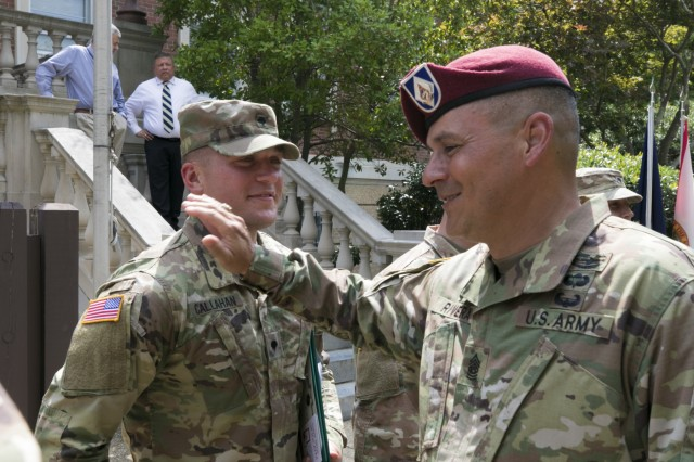 Command Sgt. Maj. Emilio Rivera, command sergeant major, Headquarters and Headquarters Battalion, Task Force Dragon, XVIII Airborne Corps, congratulates Spc. Nicholas Callahan, with the 44th Medical Brigade, for winning the 2019 XVIII Abn. Corps Soldier of the Year competition June 28, 2019 on Fort Bragg, N.C. Only those Soldiers who have won at lower echelons attended the week-long competition, embodying the Warrior Ethos and demonstrating their commitment to the Army Values. (U.S. Army photo by Pfc. Nathaniel Gayle, 22nd Mobile Public Affairs Detachment)