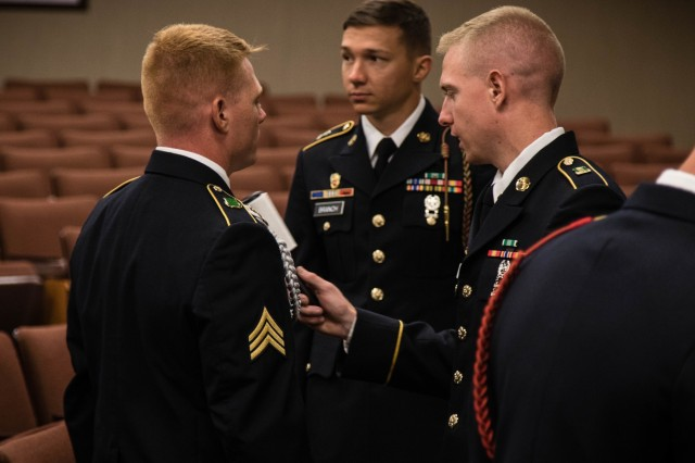 U.S. Army Soldiers participating in the 2019 XVIII Airborne Corps Noncommissioned Officer and Soldier of the Year Competition groom and prepare to enter the board portion of the competition on Fort Bragg, N.C. June 28, 2019. A board is a mental test to see which Soldier and NCO is equipped with the most knowledge on Army related material. (U.S. Army Photo by Pfc. Joshua Cowden / 22nd Mobile Public Affairs Detachment)