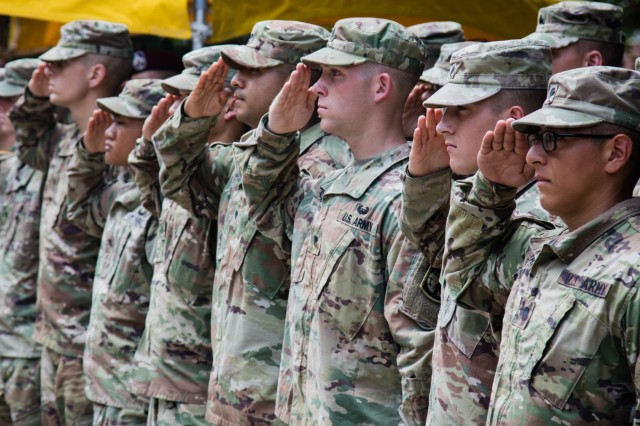 The Soldiers participating in the 2019 XVIII Airborne Corps Noncommissioned Officer and Soldier of the Year Competition salute as the national anthem is played during the final awards ceremony of the competition at Fort Bragg, N.C. June 28, 2019. The winners of the competition were Staff Sgt. Matthew Whitney, representing 3rd Infantry Division and Spc. Nicholas Callahan, representing 44th Medical Brigade. (U.S. Army Photo by Pfc. Joshua Cowden / 22nd Mobile Public Affairs Detachment)