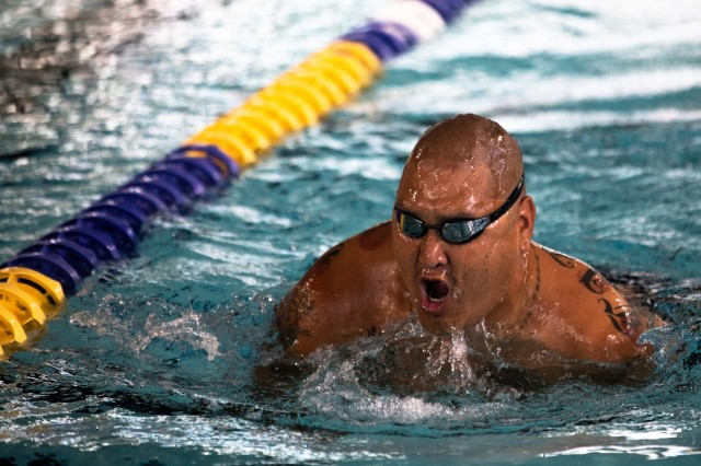 U.S. Army retired Staff Sgt. Matthew Lammers swims in the swimming event, June 29, 2019 at the Long Aquatic Center. The Department of Defense Warrior Games are conducted June 21- 30, hosted by Special Operations Command, Tampa, Florida. It is an adaptive sporting competition for wounded, ill, and injured service members and veterans. Approximately 300 athletes representing teams from the U.S. Army, Marine Corps, Navy, Air Force, Special Operations Command, United Kingdom Armed Forces, Australian Defence Forces, Canadian Armed Forces of the Netherlands, and the Danish Armed Forces will compete in archery, cycling, shooting, sitting vollyball, swimming, track, field, wheelchair basketball, indoor rowing, powerlifting, and for the first time in Warrior Games history, golf, wheelchair tennis, and wheelchair rugby. (U.S. Army photo by Staff Sgt. Michael Loggins)