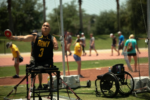 U.S. Army retired Staff Sgt. Matthew Lammers participates in seated discus during the field competition, June 23, 2019 at the University of South Florida, during the 2019 Department of Defense Warrior Games in Tampa, Florida. Approximately 300 athletes representing teams from the Army, Marine Corps, Navy, Air Force, Special Operations Command, United Kingdom Armed Forces, Australian Defence Force, Canadian Armed Forces, Armed Forces of the Netherlands, and the Danish Armed Forces are participating in 13 events throughout the competition. (U.S. Army photo by Staff Sgt. Michael Loggins)