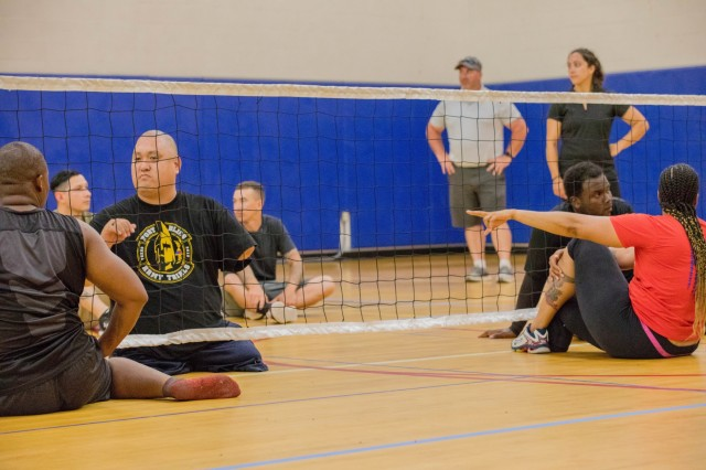 U.S. Army retired Staff Sgt. Matthew Lammers participates in a sitting volleyball training session, June 18, at the Short Fitness and Sports Center, MacDil Air Force Base, in preparation for the 2019 Department of Defense Warrior Games. The DoD Warrior Games are conducted June 21-30, hosted by Special Operations Command, Tampa, Florida. It is an adaptive sports competition for wounded , ill and injured service members and veterans. Approximately 300 athletes repesenting teams from the U.S. Army, Marine Corps, Navy, Air Force, Special Operations Command, United Kingdom Armed Forces, Australian Defence Force, Canadian Armed Forces, Armed Forces of the Netherlands, and the Danish Armed Forces will compete in archery, cycling, shooting, sitting volleyball, swimming, track, field, wheelchair basketball, indoor rowing, powerlifting, and for the first time in Warrior Games history, golf, wheelchair tennis, and wheelchair rugby.(U.S Army photo by PFC Dominique Dixon)