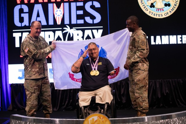 U.S. Army retired Staff Sgt. Matthew Lammers poses with U.S. Army Col. Matthew St. Laurent and Sgt. Maj. Clarence Thomas after receiving his medals, June 25, 2019 at the Tampa Convention Center, during the 2019 Department of Defense Warrior Games in Tampa, Florida. Approximately 300 athletes representing teams from the Army, Marine Corps, Navy, Air Force, Special Operations Command, United Kingdom Armed Forces, Australian Defence Force, Canadian Armed Forces, Armed Forces of the Netherlands, and the Danish Armed Forces are participating in 13 events throughout the competition. (U.S. Army photo by Staff Sgt. Michael Loggins)
