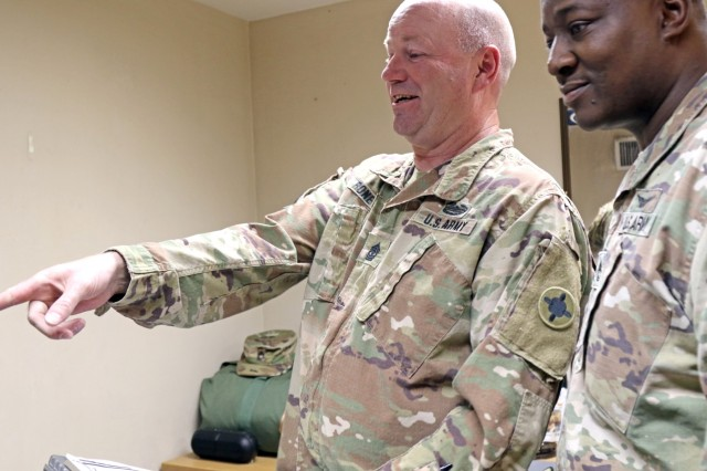 1st Sgt. Darren Rone, 184th Sustainment Command, inspects a room with Sgt. 1st Class Keith Branham at Camp Arifjan,Kuwait, June 30, 2019. (U.S. Army National Guard photo by Sgt. Connie Jones)