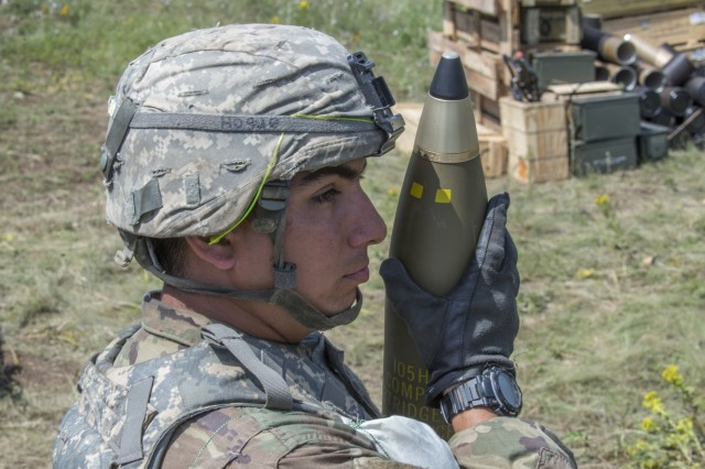 Cpl. Wyatt Houge, with Battery A, 1st Battalion, 134th Field Artillery Regiment, Ohio Army National Guard stands by with a reload round during live-fire artillery training June 13, 2019, near Varpalota, Hungary. The units participated in BREAKTHROUGH 19, a Hungarian national training exercise that utilized multiple artillery systems from the Hungarian Defence Forces, U.S. Army Europe and Army National Guard units to create a collective capability that increases the interoperability and readiness of the participating militaries.