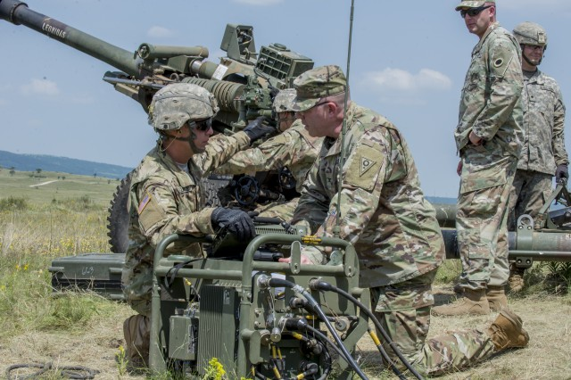 Col. Daniel Shank (right, kneeling), Ohio assistant adjutant general for Army, observes a demonstration by Soldiers with Battery A, 1st Battalion, 134th Field Artillery Regiment, Ohio Army National Guard during live-fire artillery training June 13, 2019, near Varpalota, Hungary. The units participated in BREAKTHROUGH 19, a Hungarian national training exercise that utilized multiple artillery systems from the Hungarian Defence Forces, U.S. Army Europe and Army National Guard units to create a collective capability that increases the interoperability and readiness of the participating militaries.