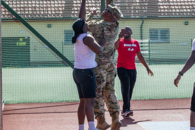 Command Sgt. Maj. John F. Sampa played basketball with Soldiers during his visit to Bemowo Piskie Training Area, Poland, June 30.