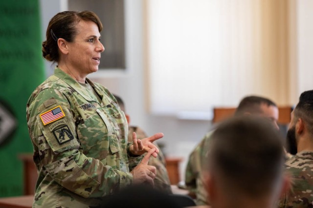 Command Chief Warrant Officer 5, Teresa A. Domeier speaks wit Soldiers about being a Warrant Officer during a visit to Bemowo Piskie Training Area, Poland, June 30.