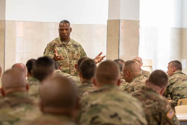 Command Sgt. Maj. John F. Sampa speaks with Soldiers during his visit at Bemowo Piskie Training Area, Poland, June 30.