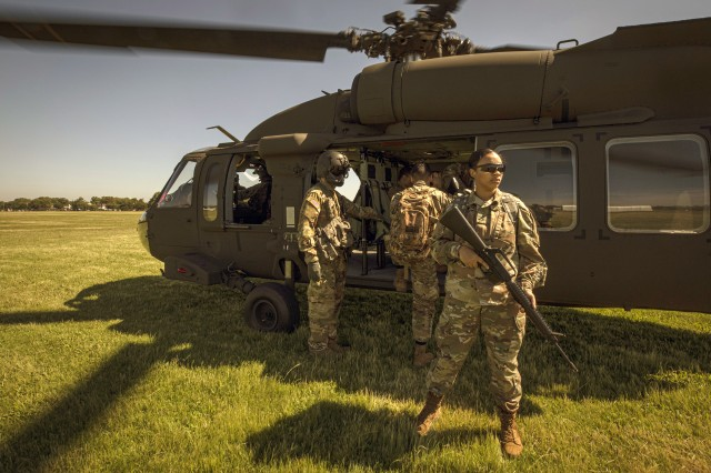 U.S. Army Soldiers provide security during a financial management support team mission on a UH-60M Black Hawk helicopter during Exercise Diamond Saber, the U.S. Army's largest finance exercise, basing operations out of the National Guard Training Center in Sea Girt, N.J. on June 26, 2019. Soldiers with 350th Finance Det. are participating in a first, remotely taking part in Diamond Saber, which is held annually at Fort McCoy, Wisconsin. Diamond Saber is designed to provide realistic technical training to regular Army, Army Reserve, and Army National Guard finance units.