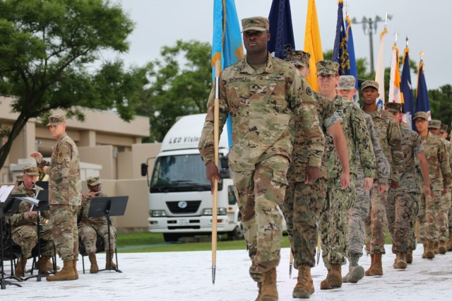 """Spc. Demarcus Boatwright, assigned to the 35th Combat Sustainment Support Battalion, leads the procession of 56 flag carriers during the """"Salute to the Nation"""" ceremony held as part of the annual open-post Independence Day celebration June 29 on Camp Zama."""