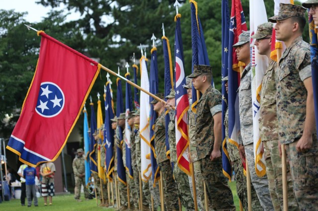 """The Tennessee state flag is presented during the """"Salute to the Nation"""" ceremony held as part of the annual open-post Independence Day celebration June 29 on Camp Zama."""