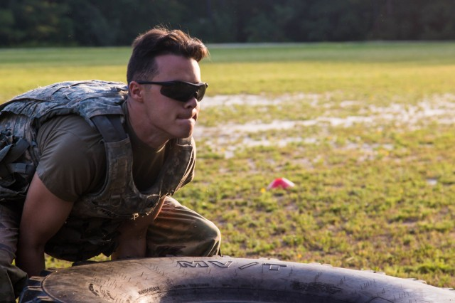 Pfc. Jakob Wrolstad, multichannel transmission systems operator-maintainer with 51st Expeditionary Signal Battalion, 35th Signal Brigade, executes a tire flip during the Soldier Readiness Test portion of the 2019 XVIII Airborne Corps Noncommissioned Officer and Soldier of the Year Competition at Fort Bragg, N.C. June 26, 2019. The competition places some of the best Soldiers in the Army against each other in a series of mental and physical challenges to determine who will be the Soldier and the Noncommissioned Officer of the Year.