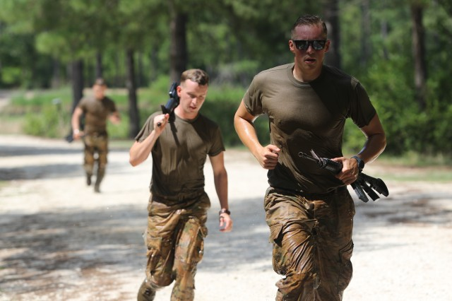 U.S. Army Soldiers conduct a terrain run after swimming across McKellar's Pond during the combat water survival training event of the 2019 XVIII Airborne Corps Noncommissioned Officer and Soldier of the Year Competition at Fort Bragg, N.C. June 24, 2019. The competition places the best of the best against each other in a week-long competition.