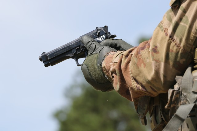 A U.S. Army Soldier readies his weapon at the M9 pistol qualification range during the 2019 XVIII Airborne Corps Noncommissioned Officer and Soldier of the Year Competition at Fort Bragg, N.C. June 26, 2019.The competition places the best of the best against each other in a grueling week of mental and physical events.