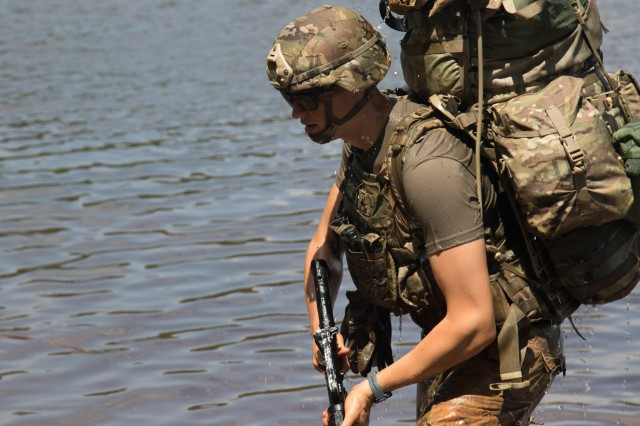 Sgt. Zachary Babin, practical nursing specialist with 759th Forward Surgical Team, 44th Medical Brigade, returns from submerging his rucksack in McKellar's Pond, during the combat water survival training event of the 2019 XVIII Airborne Corps Noncommissioned Officer and Soldier of the Year Competition at Fort Bragg, N.C. June 24, 2019. The competition places the best of the best against each other in a week-long competition.