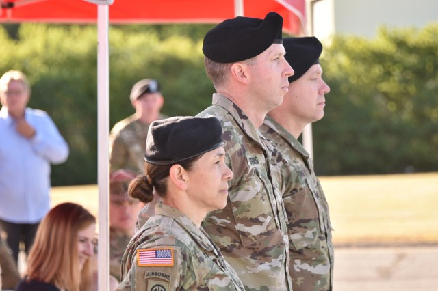 Lt. Col. Rose L. Smyth, outgoing commander (left), Col. Mark Swofford, U.S. Army Medical Department Activity Bavaria commander (center), and the incoming commander, Lt. Col. Avery J. Carney (right), stand in formation during a U.S. Army Health Clinic Grafenwoehr Change of Command Ceremony at the Tower Barracks, Grafenwoehr, Germany, July 3, 2019. (U.S. Army photo by Gerhard Seuffert)