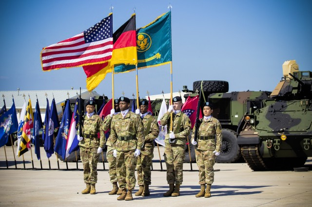 The Army Field Support Battalion-Mannheim color guard presents the colors during the change of command ceremony on Coleman Worksite in Mannheim, Germany, July 2.