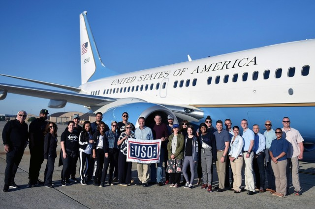 Air Force Gen. Joseph L. Lengyel, center, stands with entertainers and performers who are part of the USO tour to Europe, Africa and Southwest Asia, during a stop at Ramstien Air Base, Germany, July 2, 2019.