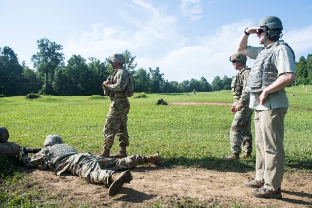 Senior Official Performing the Duties of the Secretary of the Army Ryan McCarthy watches ROTC cadets conducting a buddy live-fire exercise at Fort Knox July 3, 2019.