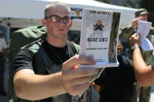 A new cadet reads the Cadet Basic Training book during Reception Day at the U.S. Military Academy at West Point July 1, 2019. During the six weeks of CBT, new cadets will be physically and mentally tested as they learn basic combat and leadership skills ahead of the academic year.