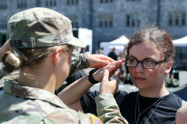 A U.S. Military Academy at West Point cadet teaches new cadets how to salute/march during Reception Day July 1, 2019. The more than 1,200 members of the Class of 2023 is composed of 285 women, 400 minorities, 17 combat veterans and 16 international students.