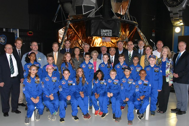 Members of the Air, Space, and Missile Defense Association pose with the 16 recipients of the 2019 ASMDA Space Camp scholarship at the U.S. Space and Rocket Center in Huntsville, Alabama, July 3. Since 1996, ASMDA has sent more than 200 students to Space Camp. (U.S. Army photo by Jason B. Cutshaw)