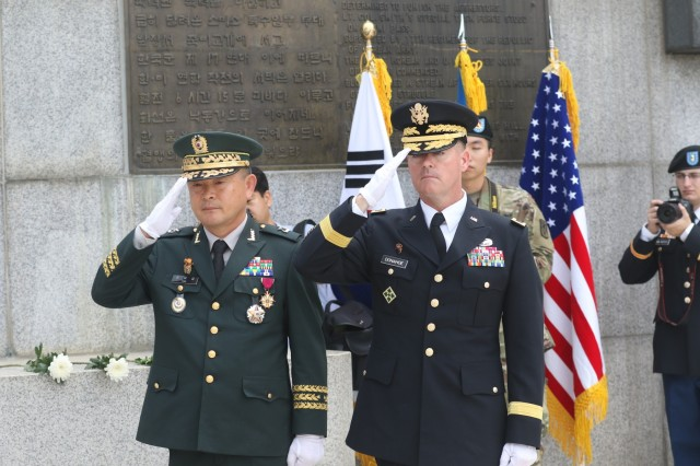 Maj. Gen. Kim, Tae Up, ROK, Eighth Army deputy commanding general (left), and Brig. Gen. Patrick Donahoe, Eight Army deputy commanding general - Operations, salute at the 69th Task Force Smith Memorial Ceremony July 3. The ceremony commemorates the first battle in Korea involving United Nations forces, which occurred July 5, 1950. The ceremony was held at the Jukmiryeong U.N. Forces First Battle Memorial in Osan, South Korea. (U.S. Army photo by Private Second Class Jun-Woong Sung)